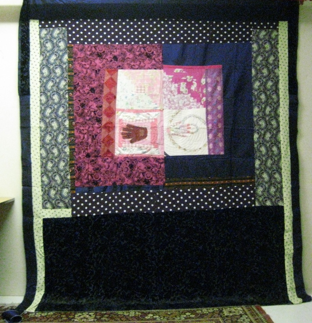 Quilt 'top' in deep purple and yellow with appliqued hand motif , made in mum's memory, featuring her own hand.