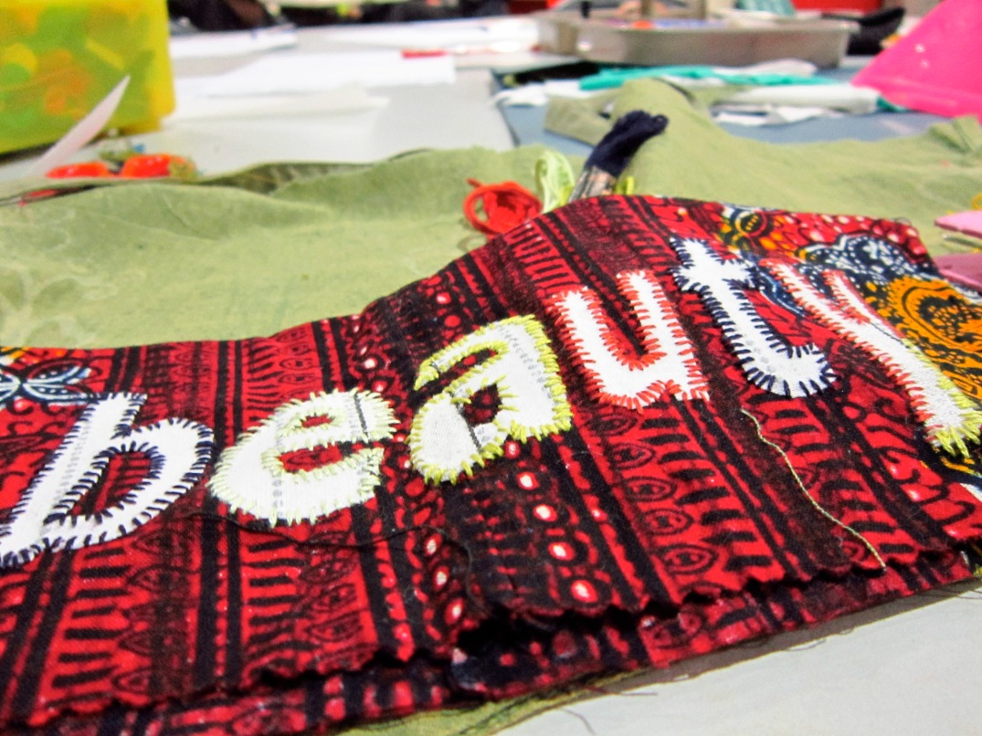Beauty-white cloth font hand embellished on red ground.