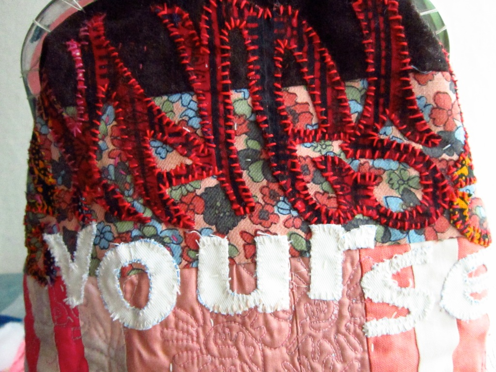 Express Yourself_6/detail©2013MaggieWinnall_Affirmative applique_Hope In Your Handbag™_purse_machine pieced and quilted textile_hand embellished applique_pink_red_white font_kisslock frame_stripes_orange_multicolour_red