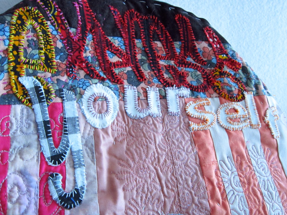 Express Yourself_13©201_Affirmative applique couture Hope In Your Handbag™wearable art purse,machine pieced and quilted textile with hand embellished letters in pink,red,white font with a kisslock frame and multicoloured stripes..JPG