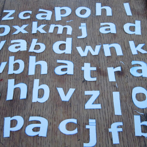 hand cut cloth type in white font by Maggie Winnall