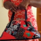 Handmade wearable art handbag in blue, green and pink by Maggie Winnall
