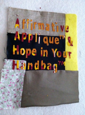 Textile artwork by MaggieWinnall of Affirmative Applique™ & Hope In Your Handbag™ letters ready for stitching,a sample for the Festival of Neighbourhood, Grow your Own Ideas Finale weekend on 7th and 8th September 2013.