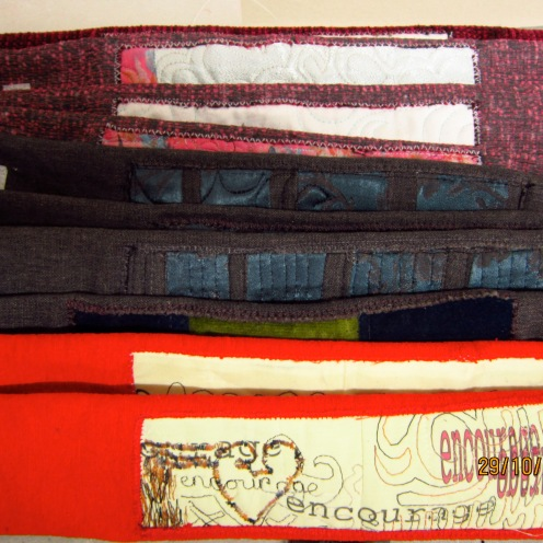 handmade Bank/Oyster Card Wallets in red, pink and petrol blue.