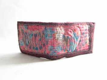 Hand stitched pink oyster /card wallet with 'encourage' as message.