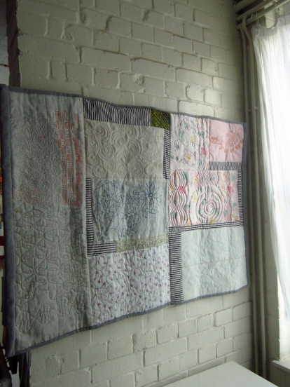 A contemporary art quilted textile in pink and whites by Maggie Winnall-Sewin Studio