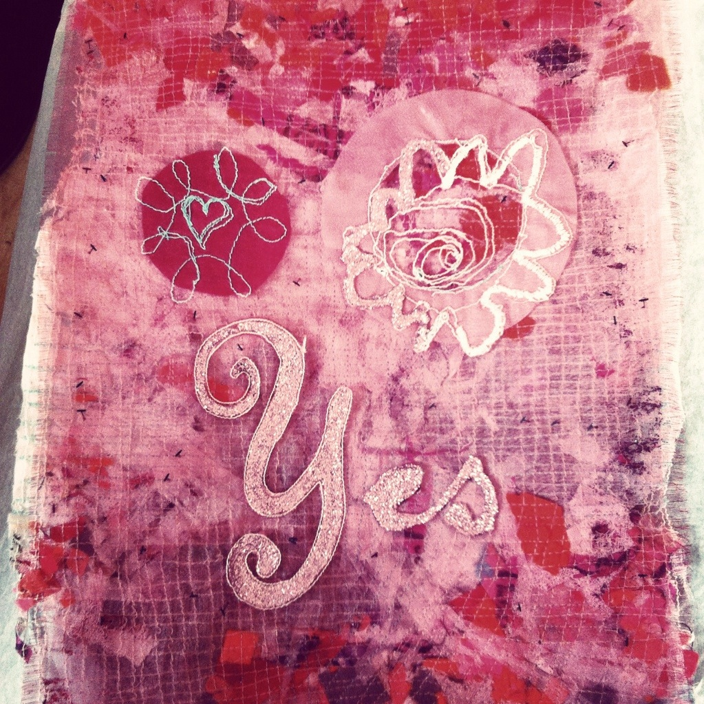 Hand painted and machine stitched mixed media textile in pink