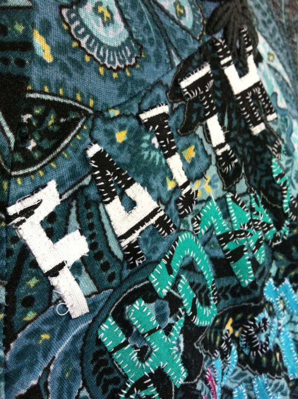 Detail of Contemporary Art Textile with hand stitched text