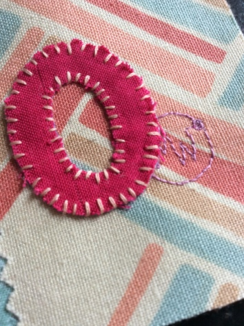 Hand stitched improvisational textile art