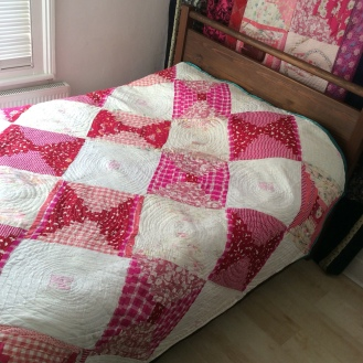 Contemporary improvisational textile art quilt in pink and white by Maggie Winnall at Sewin Studio.