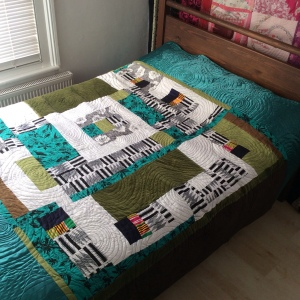 Contemporary improvisational quilt art in pink and green by Maggie Winnall at Sewin Studio.