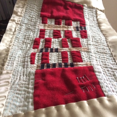 Red and green hand stitched textile art by Maggie Winnall at Sewin Studio