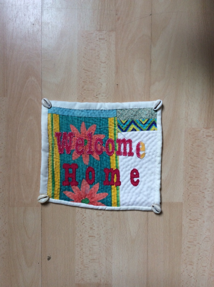 Contemporary Hand quilted and stitched textile embellished with hand cut letters by Maggie Winnall